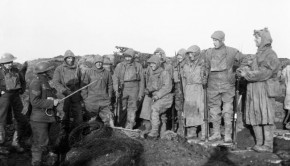 Men of the York and Lancashire Regiment, wearing camouflage suits, prepare for a trench raid near Roclincourt, 12 January 1918.